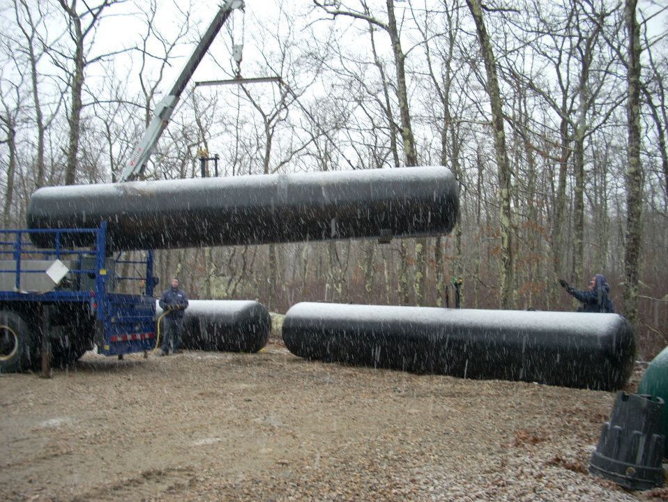 Propane tanks being installed in the snow
