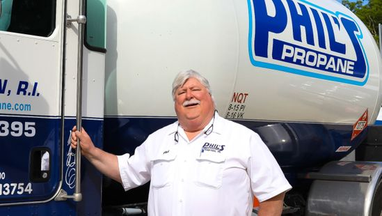 Phil's Propane employee and propane delivery truck